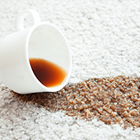 image of coffee spilled on carpet
